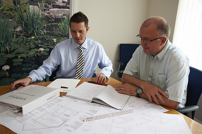 Southern BCP surveyors at a plans meeting